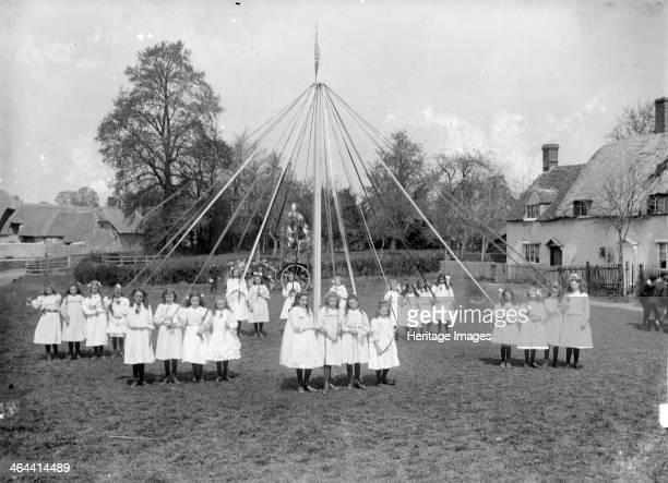 Village children taking part in the maypole dance at East Hanney Oxfordshire c1860c1922