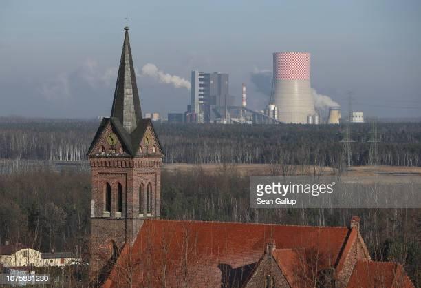 A village church stands near the Jaworzno II coalfired power station in the coalheavy region of Silesia on November 29 2018 near Jaworzno Poland The...
