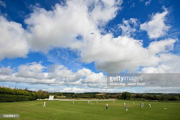 village cricket monday blues - cricket pitch stock pictures, royalty-free photos & images