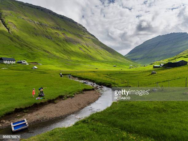 Village Elduvik located at fjord Funningsfjordur Europe Northern Europe Denmark Faroe Islands