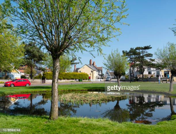 village green and pond at thorpeness, suffolk - aldeburgh stock photos and pictures