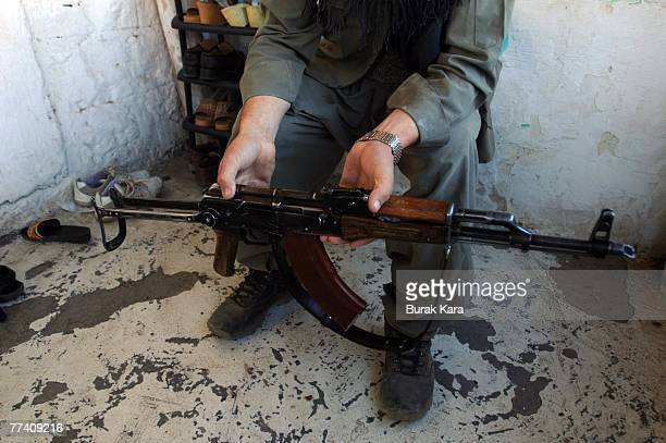 A village guard show his AK47 in the southeastern Turkish province of Sirnak October 19 2007 Turkey's parliament resoundingly approved a motion on...
