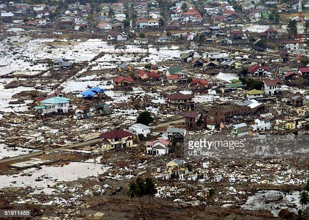 A village heavily damaged is shown January 2 2005 near the coast of Sumatra Indonesia Humanitarian relief operations are being conducted by sailors...