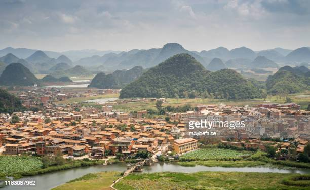 village in the mountains - south china stock pictures, royalty-free photos & images