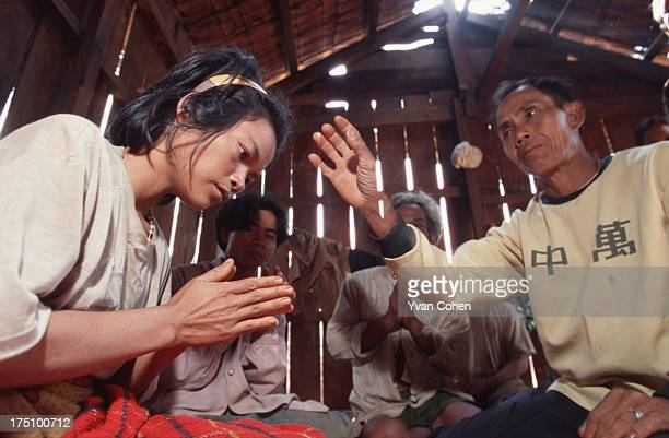 BOUSRA MONDOLKIRI CAMBODIA A village leader blessing a young Phnong girl suffering from depression The girl has her hands clasped together in a...
