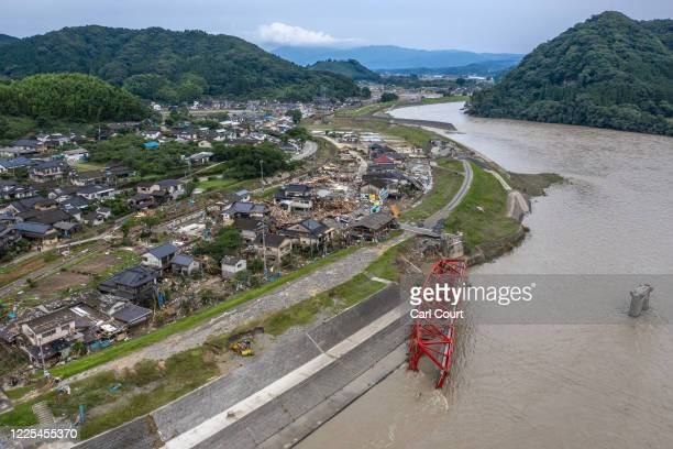 Village lies in ruins after being flooded by the nearby Kuma River following torrential rain, on July 8, 2020 in Kuma, Japan. Around 60 people are...
