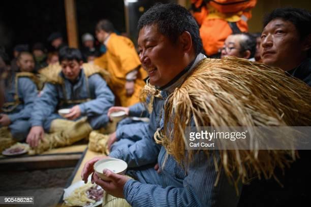 A village man drinks sake at the beginning of the Nozawaonsen Dosojin Fire Festival on January 15 2018 in Nozawaonsen Japan The festival is staged by...