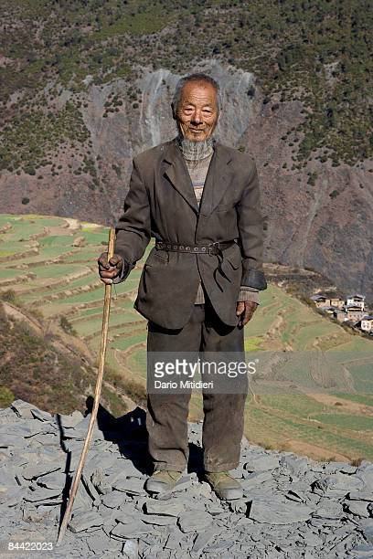 A village man standing on the side of the road from Shangri La to Yading a reserve in southwest Sichuan Province China This area of southwestern...