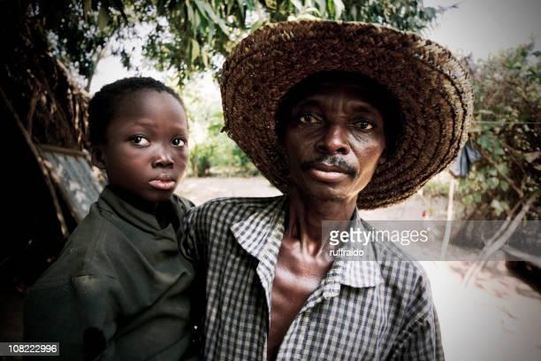 village man with son