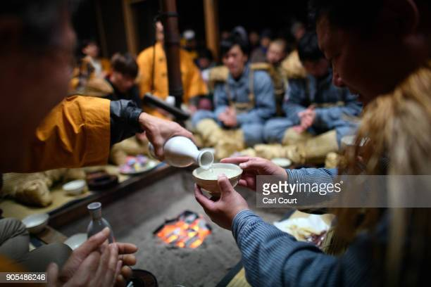 A village men is poured sake at the beginning of the Nozawaonsen Dosojin Fire Festival on January 15 2018 in Nozawaonsen Japan The festival is staged...