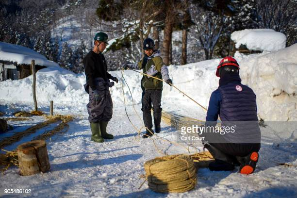 Village men prepare rope that will be used in the construction of the shrine during preparations for the Nozawaonsen Dosojin Fire Festival on January...