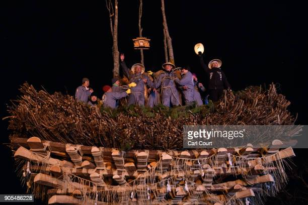Village men sit atop the shrine during the Nozawaonsen Dosojin Fire Festival on January 15 2018 in Nozawaonsen Japan The festival is staged by...
