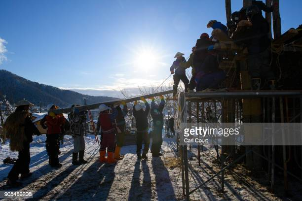 Village men work on building a shrine during preparations for the Nozawaonsen Dosojin Fire Festival on January 14 2018 in Nozawaonsen Japan The...
