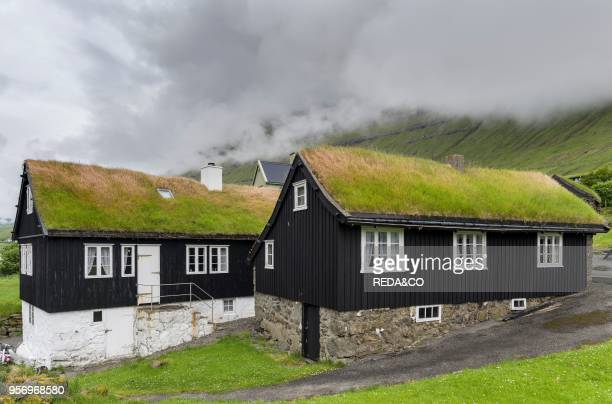Village Nordragota with traditional sod roofed houses The island Eysturoy one of the two large islands of the Faroe Islands in the North Atlantic...