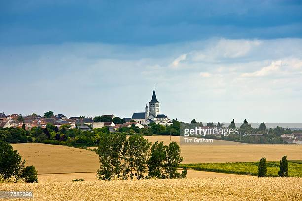Village of Faye La Vineuse with tall spire Loire Valley France