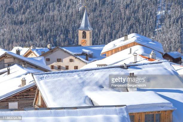 village of latsch after a snowfall. bergun, albula valley, district of prattigau/davos, canton of graubünden, switzerland, europe. - davos stock pictures, royalty-free photos & images