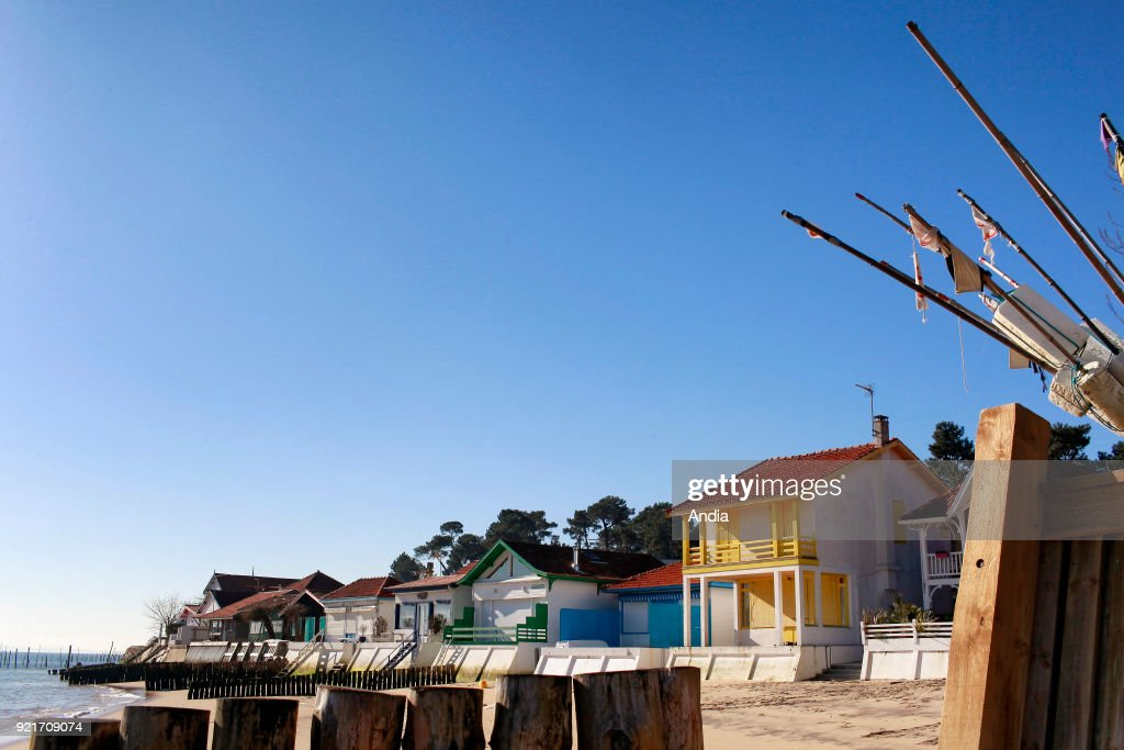 Village of L'Herbe (south-western France), in the Arcachon Bay. Villas along the waterfront and sand beach.