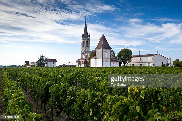 Village of Pomerol with vineyard Chateau St Pierre and Church of St Jean in the Bordeaux wine region of France