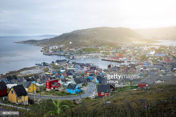 village of qaqortoq in greenland by the coastline. - greenland stock pictures, royalty-free photos & images
