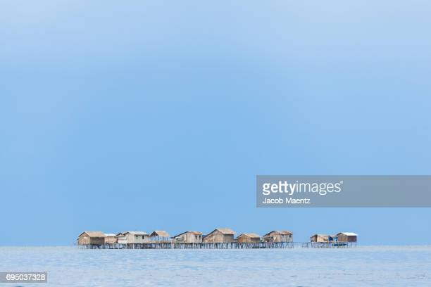 Village of stilted houses over water.