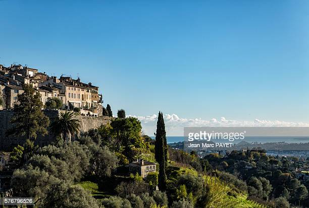 village on a hill in front of the sea - jean marc payet stock pictures, royalty-free photos & images