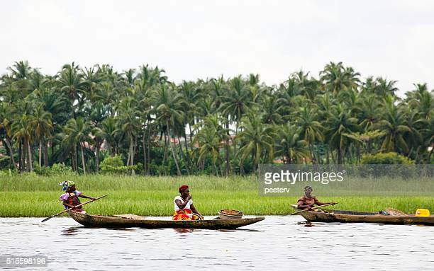 village on the water. ganvie, benin. - dugout canoe stock photos and pictures