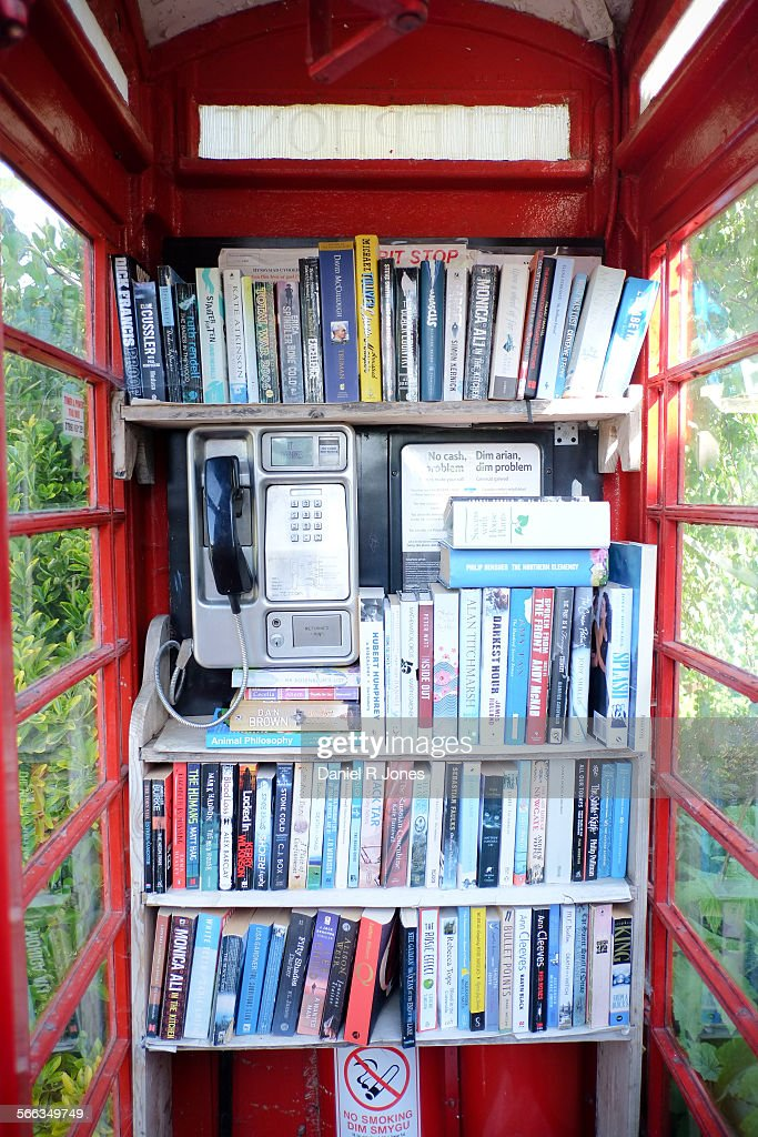 A village phone box in Michaelstone-le-Pit, Vale of Glamorgan, Wales being put to good use as the village library.