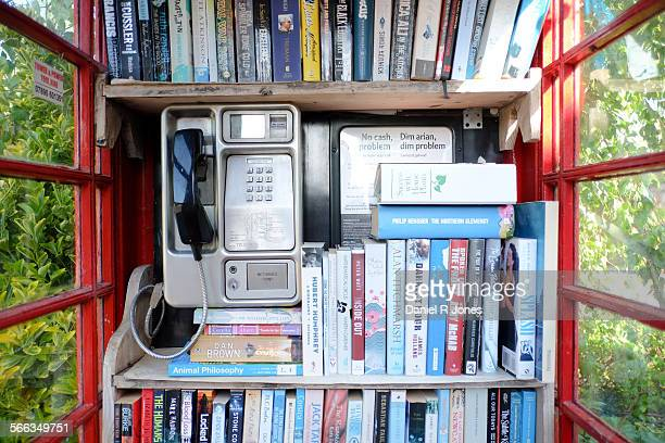 A village phone box in MichaelstonelePit Vale of Glamorgan Wales being put to good use as the village library