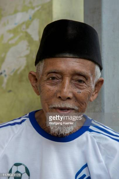 Village scene with a portrait of an elderly man in the Bajau Sea Gypsy village on Bungin Island, famous for living in stilt houses above the water...