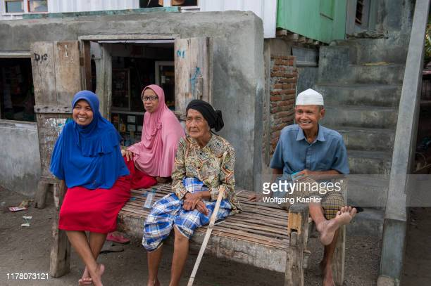 Village scene with local people in the Bajau Sea Gypsy village on Bungin Island, famous for living in stilt houses above the water and living...