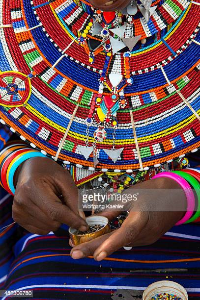 Village scene with Masai women making glass bead jewelry in a Masai village outside Amboseli National Park in Kenya