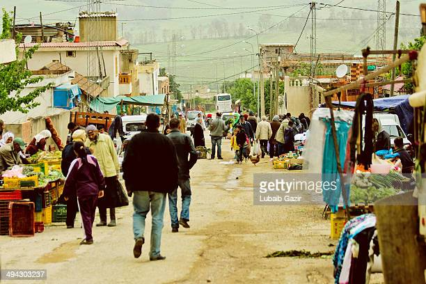 CONTENT] Village street market in the poor village region of Ain Draham in Tunisia Villagers from around the village gather every Thursday of the...