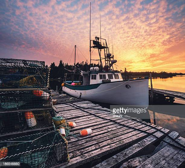 village wharf in sunset - lobster fishing stock photos and pictures