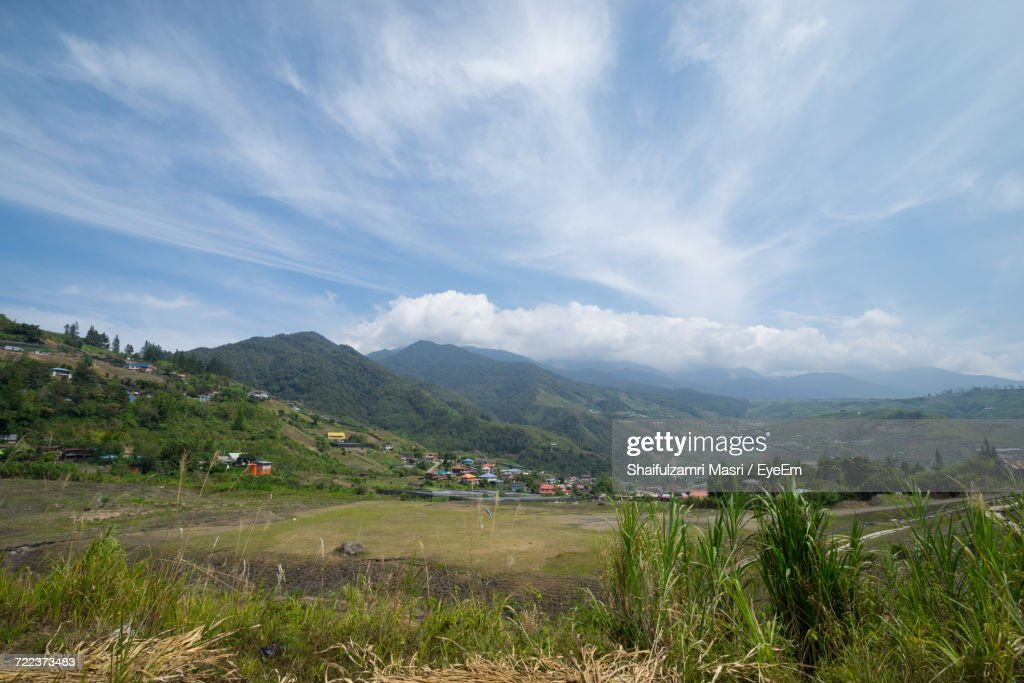Village With Mountain Range In Background : Stock Photo