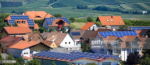 village with solar panel houses - solar energy dish stock pictures, royalty-free photos & images