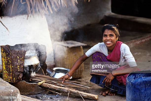 A village woman cooking in the Nilgiris Tamil Nadu India