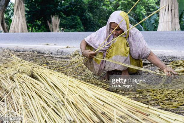 Village woman seen processing jute. Jute is Bangladesh's golden fiber and it plays a major role in the national economy. In Bangladesh, 80 percent of...