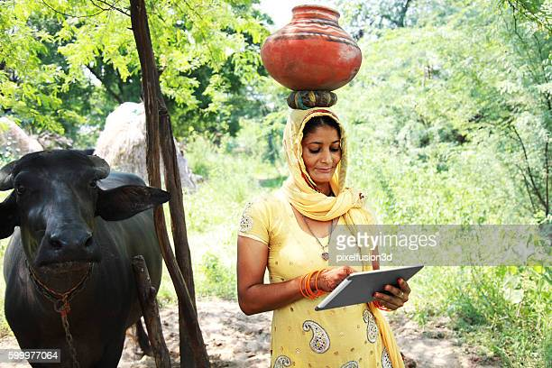 Village women using digital tablet