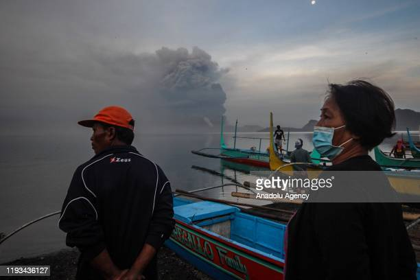 Villager are seen as they look at Taal volcano erupting in Batangas Philippines on January 13 2020