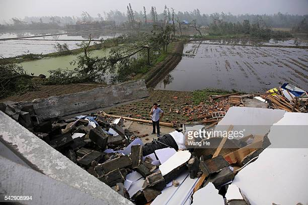A villager called up a collapsed house in Danping Village of Chenliang Township in Funing Yancheng east China's Jiangsu Province June 25 2016 A total...