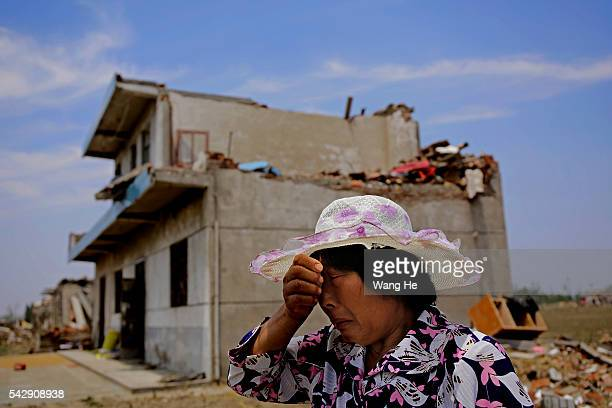 A villager cries in front of a damaged house in Danping Village of Chenliang Township in Funing Yancheng east China's Jiangsu Province June 25 2016 A...