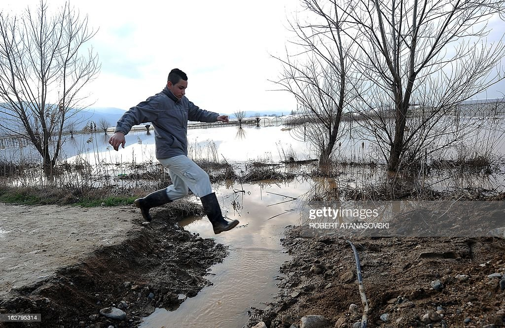A villager crosses the flooded fields in the village of Monospitovo, in the southeastern tip of the Republic of Macedonia on February 27, 2013. The torrential rains which in the last three days poured down on the fertile Strumica Valley inundated fields and villages, destroying or damaging crops and households. Tens of people in the region are now sheltered, as their homes were gravely damaged.
