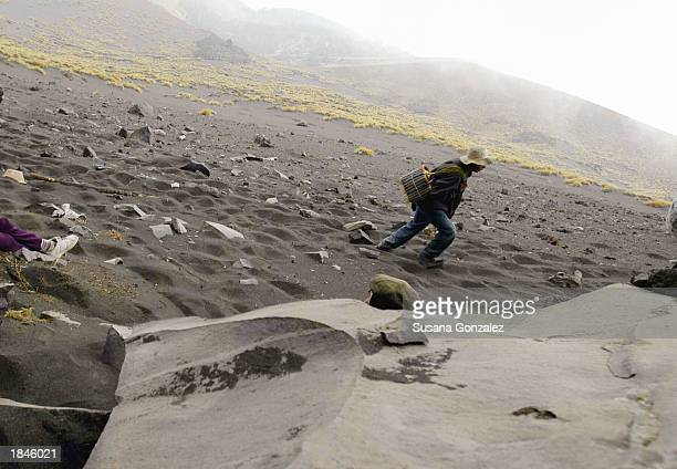 A villager from one of the closest towns around the Popocateptl Volcano climbs and walks for miles before arriving to the shrine where he will...