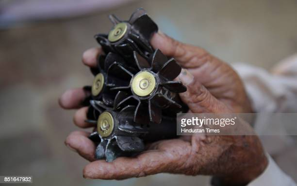 A villager holds a mortar shell fired from the Pakistan side of the border at Jabowal village in Arnia sector near the IndiaPakistan international...