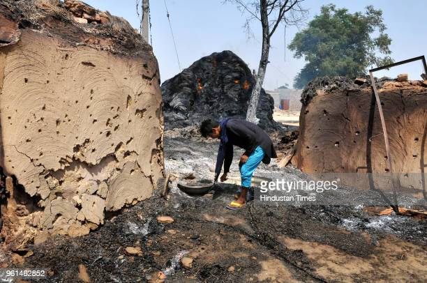 A villager inspects the damage after his home that was gutted by firing from the Pakistan side of the border at Jora farm village on May 22 2018 in...