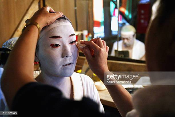 A villager is daubed in makeup in preparation for a Kabuki performance on August 18 2004 in Hinoemata Fukushima Japan The residents of Hinoemata have...
