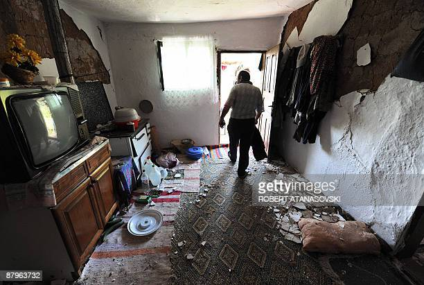A villager looks at the damage to his house after an earthquake hit the village of Basi Boz near the town of Valandovo some 160 km east of Skopje on...