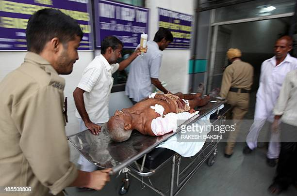 A villager named as Vijay Kumar is transported by medical staff at a hospital in Jammu after he was injured in crossborder firing in...