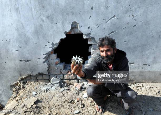A villager showing mortar shell near damaged wall of his house fired from the Pakistan side of the border at Arnia sector on January 19 2018 in Jammu...