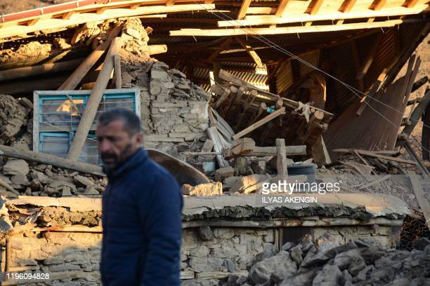 A villager stands by his collapsed house after an earthquake in Sivrice near Elazig Eastern Turkey on January 25 2020 A powerful earthquake has...